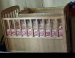 Baby crib with swing